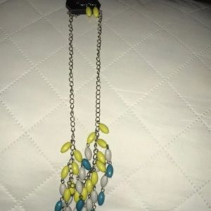 Multi colored beaded necklace with earrings